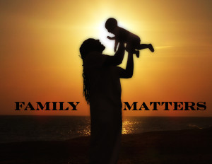 Father baby sunset family matters_text